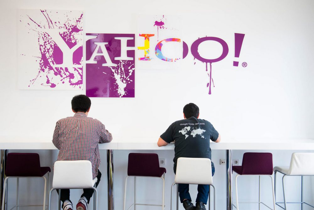 Men sat in Cafe with Yahoo sign
